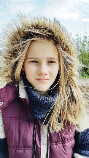 Portrait of girl in warm cloths during winter
