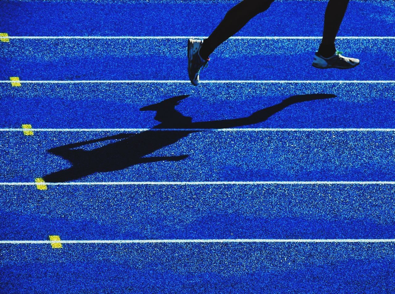 Low section of runner running on track