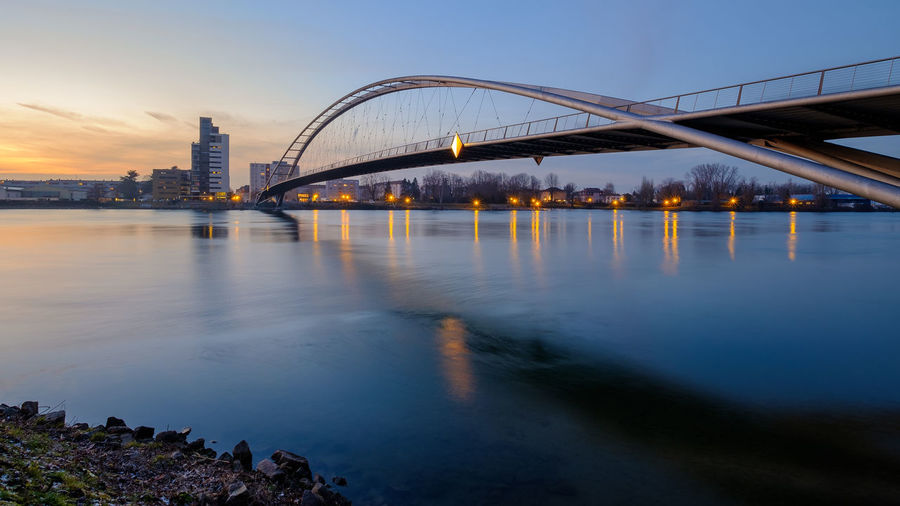 Die Dreiländerbrücke in Weil am Rhein Architektur Architekturfotografie Baden-Württemberg  Bridge Brücke Deutschland Dreiländerbrücke Fuji Germany Langzeitbelichtung Sonnenuntergang Südbaden Weil Am Rhein X-t2 Architectural Photography Architecture Long Exposure Sundown Sunset Time Exposure Water Built Structure Sky Connection Bridge - Man Made Structure River Nature Transportation Building Exterior City Reflection No People Illuminated Travel Destinations Dusk Outdoors Arch Bridge Long