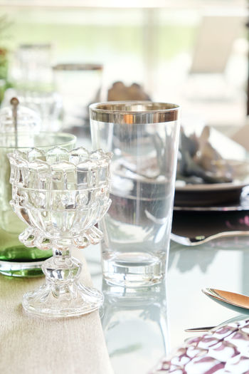 Detail image of Elegant dining table setting Dining Room Elegant Celebration Close-up Day Dining Dining Area Dining Table Dining Tables And Chairs Diningroom Drinking Glass Focus On Foreground Indoors  No People Place Setting Table Wineglass