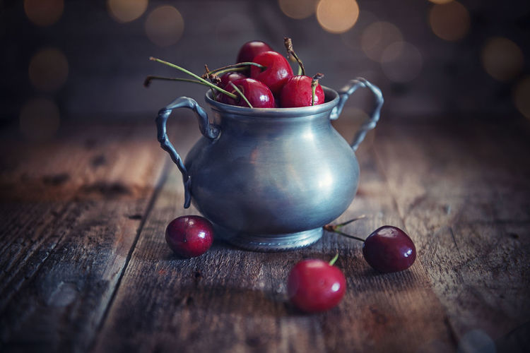Cherries cup Cherries Cherry Bookeh Cherry Food Food And Drink Freshness Fruit Healthy Eating Light Effects No People Red Rustic Style Still Life Sweet Fruit Table Wood - Material