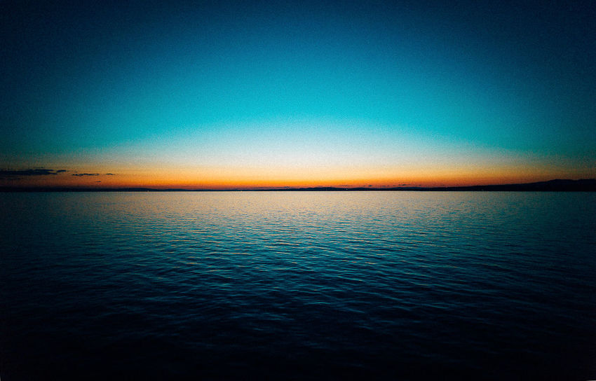 VSCO Beach Beauty In Nature Blue Clear Sky Day Horizon Over Water Idyllic Leica Nature No People Outdoors Rippled Scenics Sea Silhouette Sky Sunset Tranquil Scene Tranquility View Into Land Water Waterfront