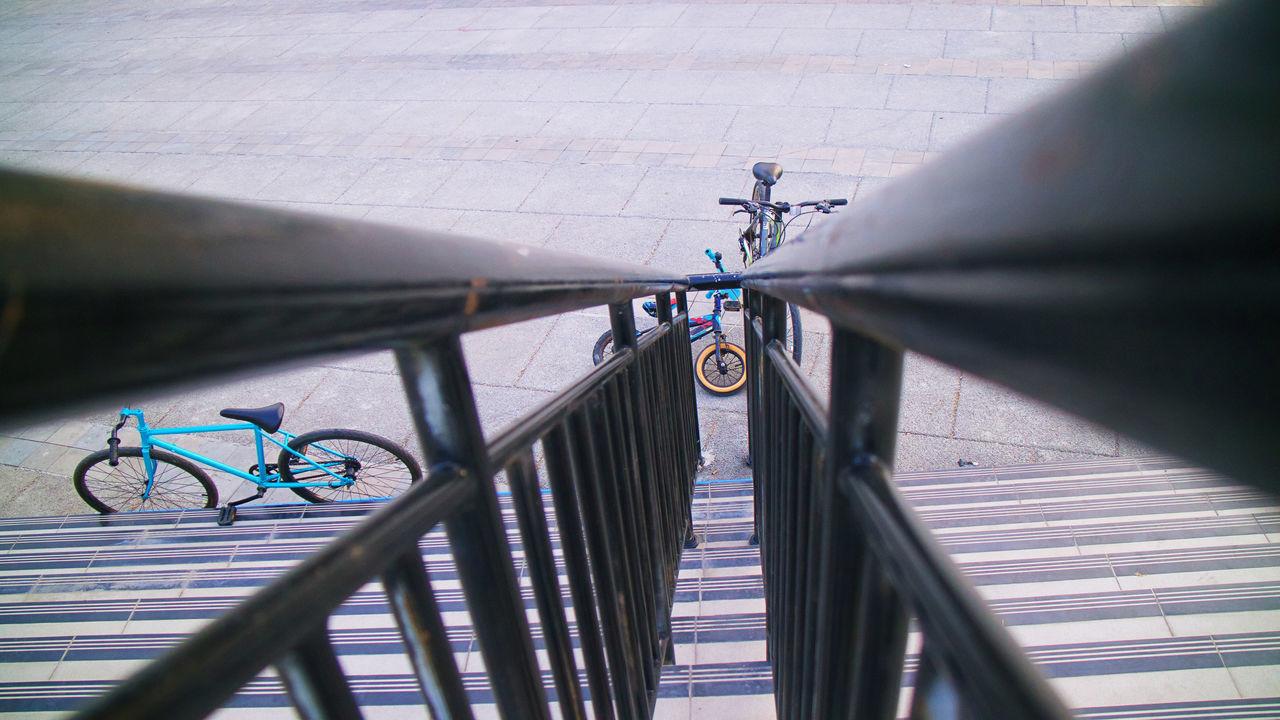 HIGH ANGLE VIEW OF BICYCLE RAILING ON METAL BRIDGE