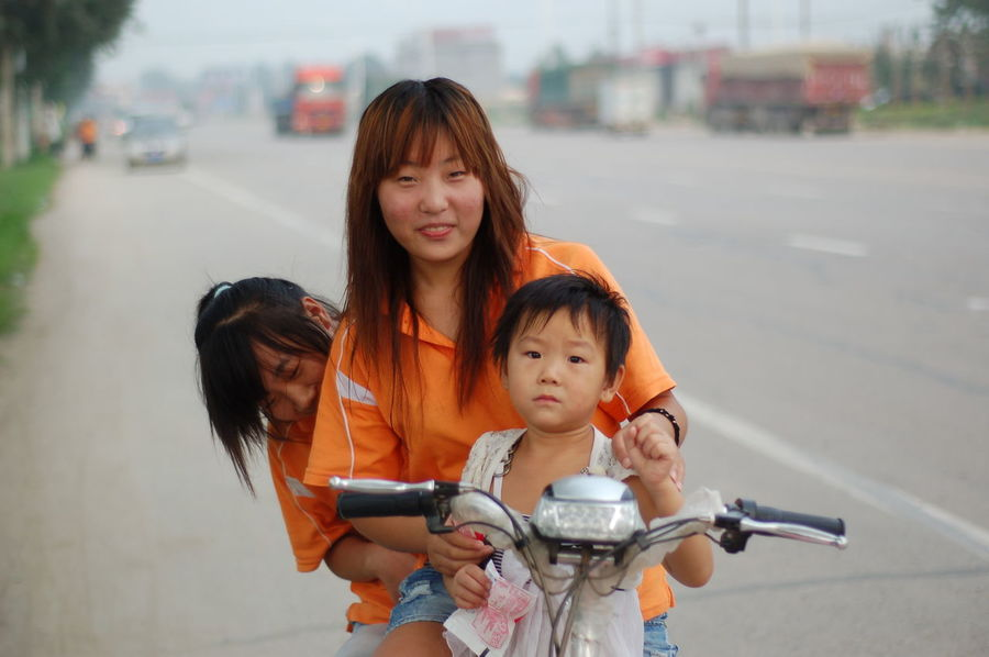Chinese Family China Daughter Factory Workers Family Focus On Foreground Looking At Camera Mother Portrait Real People Road Smiling Street Transportation