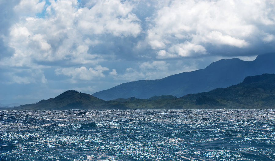 Cloud - Sky Mountain Sky Beauty In Nature Scenics - Nature Tranquil Scene No People Tranquility Waterfront Mountain Range Day Water Nature Sea Non-urban Scene Outdoors Idyllic Environment Remote View From Boat Choppy Sea Stormy Clouds Dominican Republic Landscape