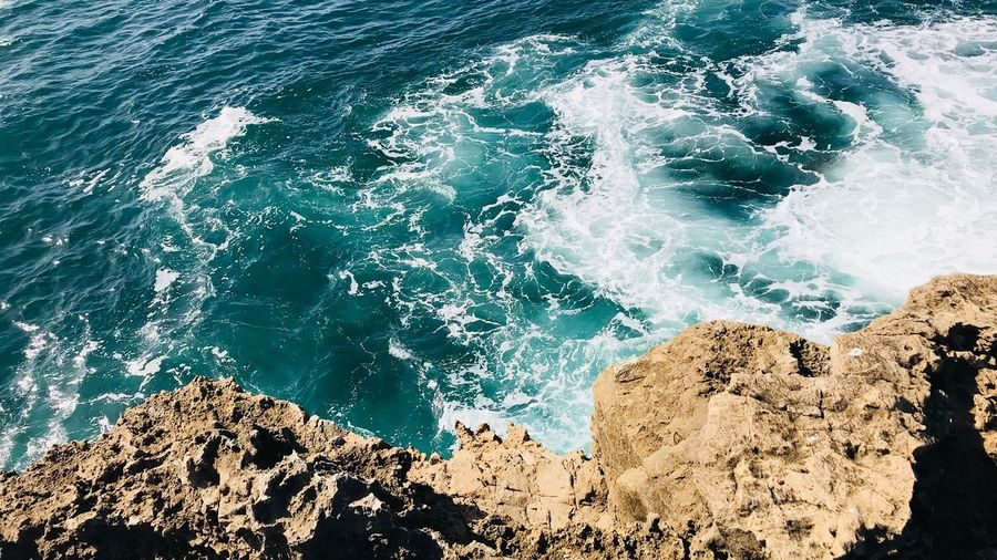 Cliffs near Lisbon EyeEmNewHere Shore Cliff Water Sea Nature Motion High Angle View Day No People Wave Rock Rock - Object Power In Nature Beauty In Nature First Eyeem Photo EyeEmNewHere