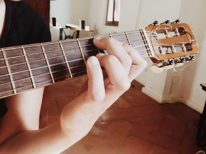 Musical Instrument Music Guitar Playing Musical Equipment Indoors  Human Hand One Person Arts Culture And Entertainment Fretboard Musician Electric Guitar Leisure Activity Human Body Part Real People Plucking An Instrument Lifestyles Skill  Close-up