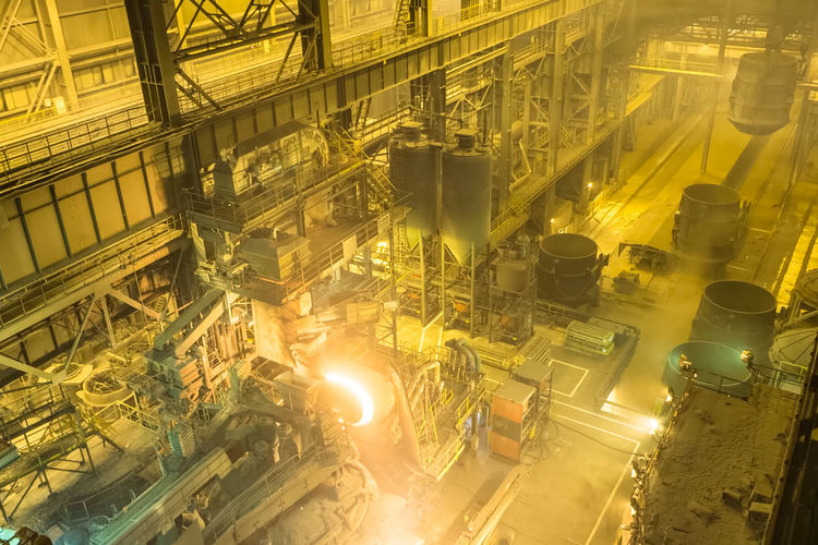 Industry Factory Fuel And Power Generation Illuminated No People Machinery Yellow Technology Metal Equipment Indoors  Manufacturing Equipment Pipe - Tube High Angle View Business Complexity Manufacturing Glowing Industrial Equipment Production Line Metal Industry Chemical Plant Food Processing Plant