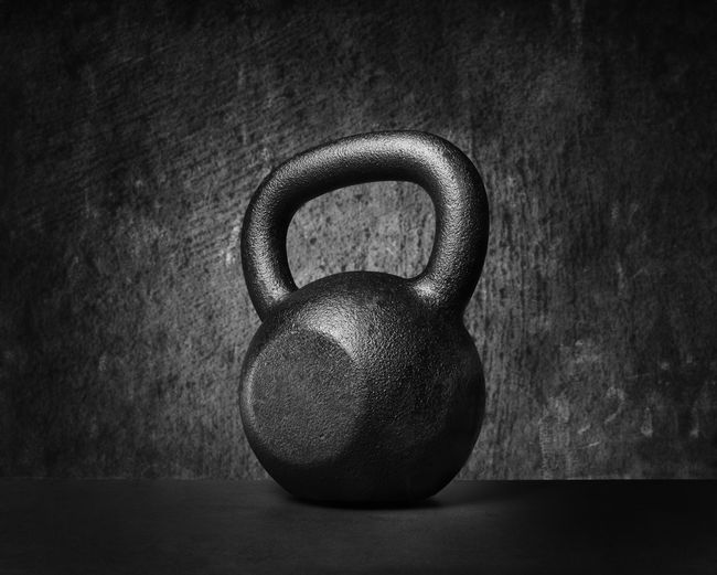 Black and whit image of a rough and tough heavy 30 kg 66 lbs cast iron kettlebell. Black Bodybuilding Close-up Equipment Excercising Fitness, Heavy Hello World Iron Kettle Bell Kilo Kilogaram Kilograms Metal Monochrome No People Nobody Object Rough S Sport Strength Tree Weight Women