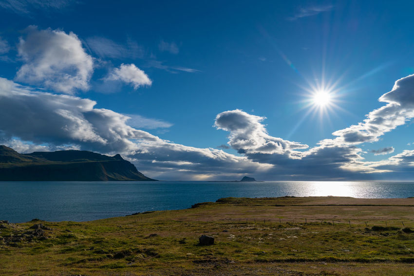 Iceland Backgrounds Beautifuliceland Beauty In Nature Bright Cloud - Sky Day Fjord Idyllic Land Lens Flare Mountain Nature No People Non-urban Scene Outdoors Scenics - Nature Sea Sky Sun Sunbeam Sunlight Tranquil Scene Tranquility Water My Best Travel Photo Holiday Moments Capture Tomorrow
