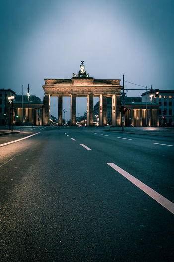 Berlin Brandenburg Gate Architectural Column Architecture Brandenburger Tor Building Exterior Built Structure City City Gate Clear Sky History Illuminated Monument Night No People Outdoors Sky Statue Tourism Transportation Travel Travel Destinations Triumphal Arch