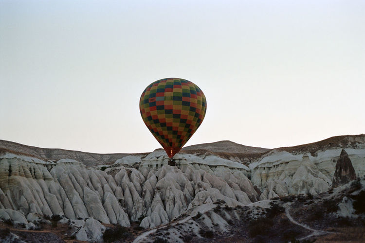 35mm Film Ballooning Festival Beauty In Nature Clear Sky Day Film Photography Filmisnotdead Flying Hot Air Balloon Landscape Mid-air Mountain Nature No People Outdoors Rock - Object Scenics Sky