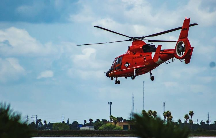 Sky Cloud - Sky Helicopter Outdoors Flying Mid-air Air Vehicle Inthemoment Rgv Enjoying Life Outdoor Photography Photographyislifee Photographylovers Photojournalism EyeEmNewHere Enjoying The Moment Men Coastguard Real People Airport Day Occupation Focus On Foreground Orange Color Uscoastguard