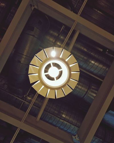 Low angle view of illuminated pendant light in building