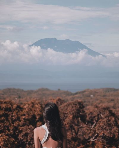 Mount Agung peaceful as ever in the distance Volcano Mount Agung Mountain Vacations Holiday INDONESIA Bali Sky Real People Rear View One Person Nature Cloud - Sky Mountain Outdoors Beauty In Nature Day Landscape People Scenics Lifestyles Young Adult Women Young Women