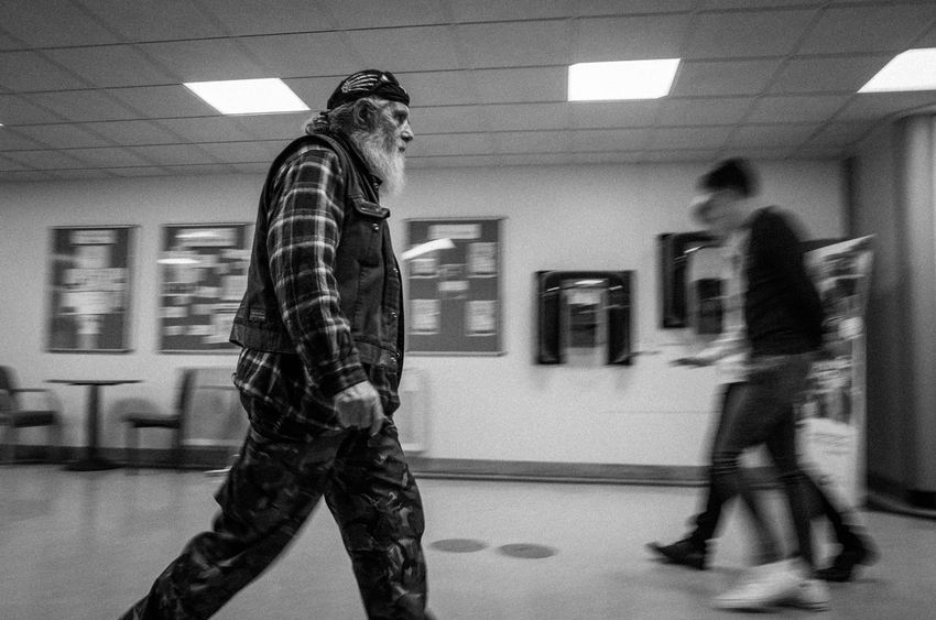 Biker male walks past camera. Image captured with slow shutter speed for motion blur. Bandana Man Adult Beard Biker Blurred Motion Indoors  Men Monochrome Monochrome Photography One Person Real People Street Street Photography Streetphoto_bw Streetphotography