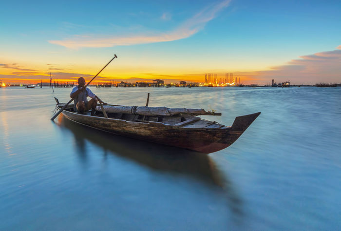 Boat fishing at sunset Sunrise N Sunsets Worldwide  Sunrise_Collection Sunset_collection Beauty In Nature Landscape_photography Mode Of Transport Moored Nature Nautical Vessel Outdoors Sea And Sky Seascape Sky Sunrise Sunset Transportation Water