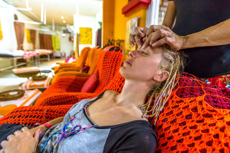 Woman Getting Head Massage At Salon