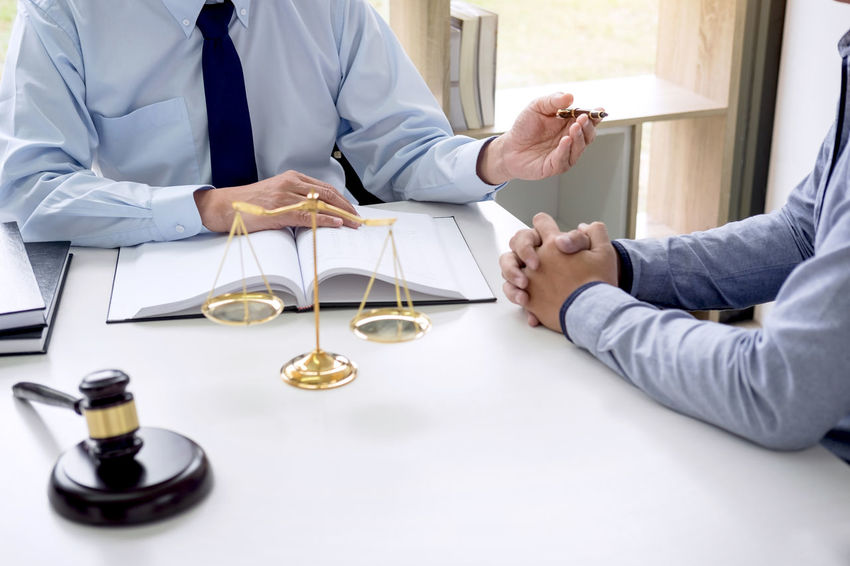 Lawyer Balance Barrister Business Consultant Counselor Customer  Fairness Gavel Hand Holding Human Hand Indoors  Judge Judgement Justice Legal Men Occupation People Professional Occupation Sitting Togetherness Two People Verdict