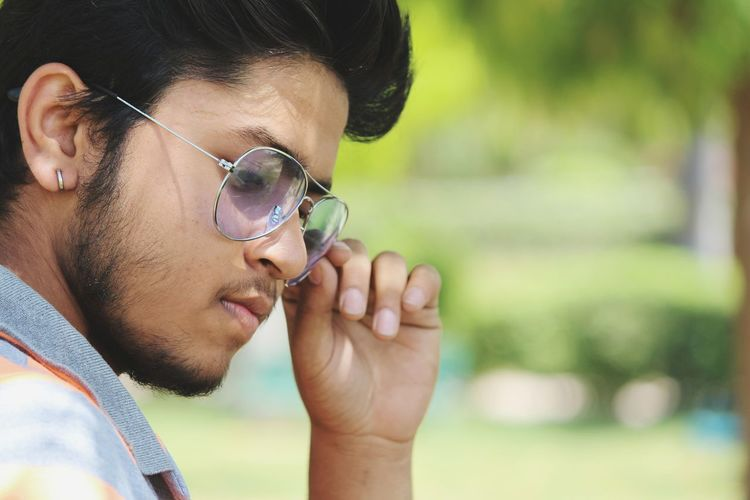 Rahul - Abshine photography Rahul Abshine Abshine_photography Canon Canon1200d Canonphotography Delhi Photography Photographyoftheday Picoftheday DSLR Camera Only Men Headshot Adult Men One Man Only Adults Only Eyeglasses  Outdoors One Person Human Face Close-up Nature Flower Portrait