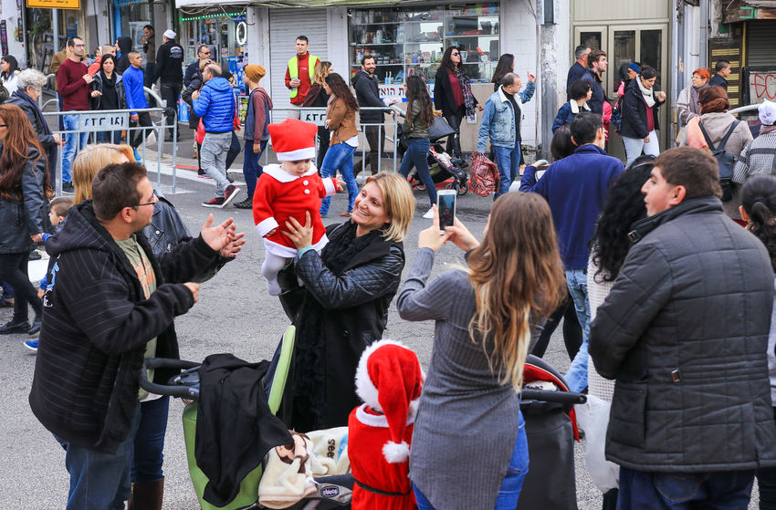 Haifa, Israel - December 17, 2016 : Young mother walking with little Santa Claus on the Christmas market in the German Colony in Haifa, Israel Adult Baby Beautiful Child Childhood Christmas Claus Colony Day December Family German Haifa Happiness Happy Holiday Israel Little Market Mother People Santa Season  Women Young