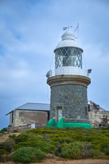 Lighthouse on Breaksea Island Albany Western Australia Built Structure Architecture Sky Building Exterior Cloud - Sky Nature Tower Plant No People Day Low Angle View Lighthouse Land Outdoors Grass Building Breaksea Island Lighthouse Southern Ocean Coastal Feature Western Australia