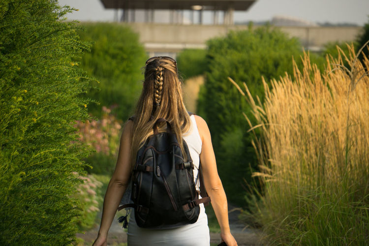 Agriculture Backpack Countryside Day Focus On Foreground Grass Green Green Color Growth Hiding Outdoors Plant Rear View Rural Scene Selective Focus Walking Woman Young Adult People And Places Casual Clothing My Year My View Traveling Home For The Holidays EyeEm Masterclass Multi Colored Lifestyles Uniqueness EyeEm LOST IN London Love Yourself Mobility In Mega Cities Press For Progress