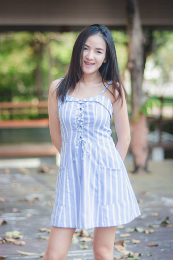 Hair Hairstyle Long Hair Fashion Beauty Looking At Camera One Person Dress Beautiful Woman Portrait Focus On Foreground Clothing Standing Three Quarter Length Young Adult Front View Women Smiling Sleeveless  Teenager Outdoors