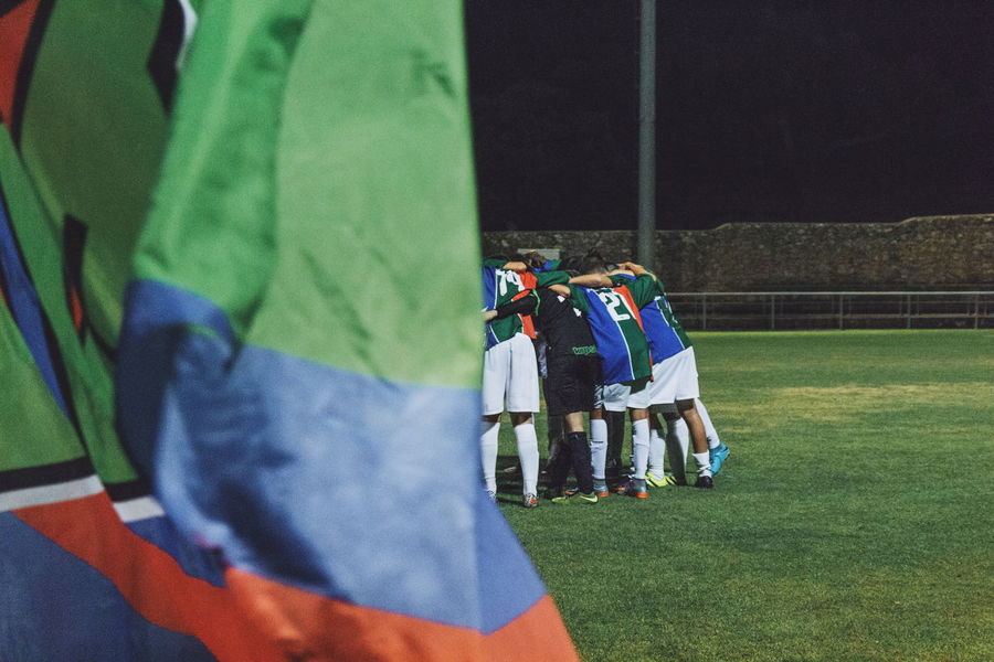 EyeEm Selects Real People Outdoors Leisure Activity Sport People Teamwork Sports Team Soccer Field Soccer Boys Soccer Tournament⚽ Youth Culture Friendship Flags In The Wind  Flag Sports Match - Sport Moments Of Life