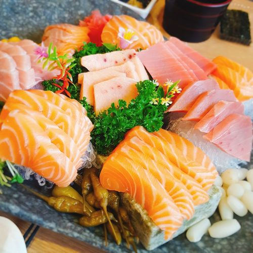 High angle view of salmon sashimi in plate on table