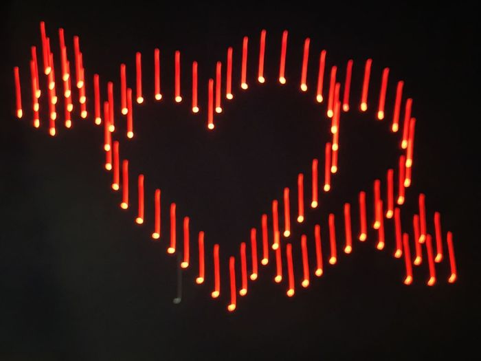 Close-up of illuminated lights over black background