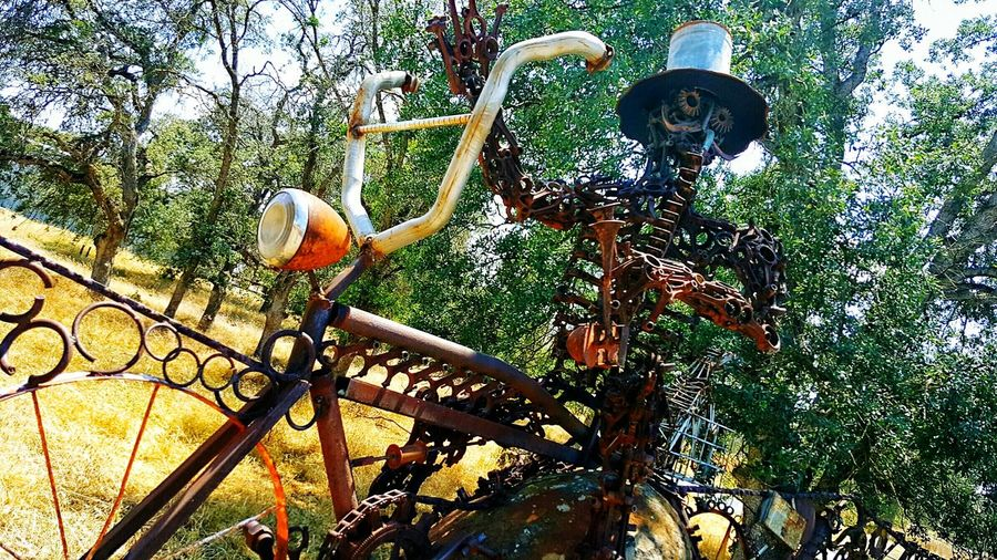 Tollhouse, Ca Fense Gate Creative Creative Power Recycled Materials Recycled Art Details Look Closely Taking Photos From My Point Of View Robot Music Motorcycle Handlebars Street Art Handlebar Mustache Tool Man Sunny Day Art Top Hat Countryside Off A Country Road Bicycle Waving