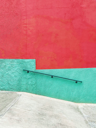 High angle view of a geometric green and red wall