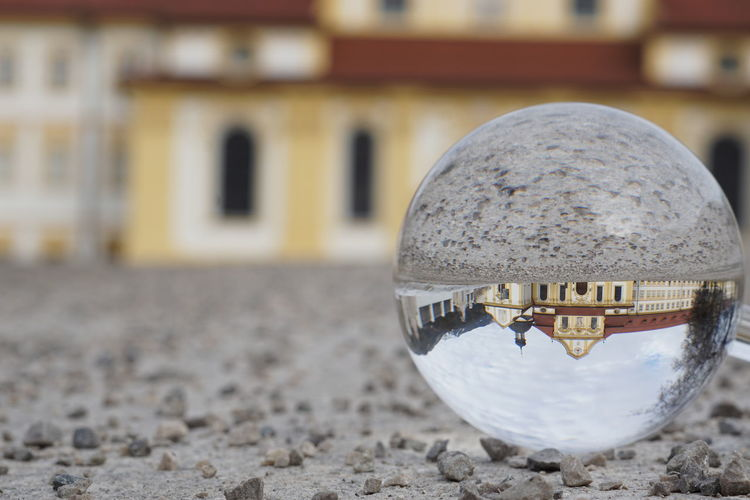 Close-up of crystal ball on land