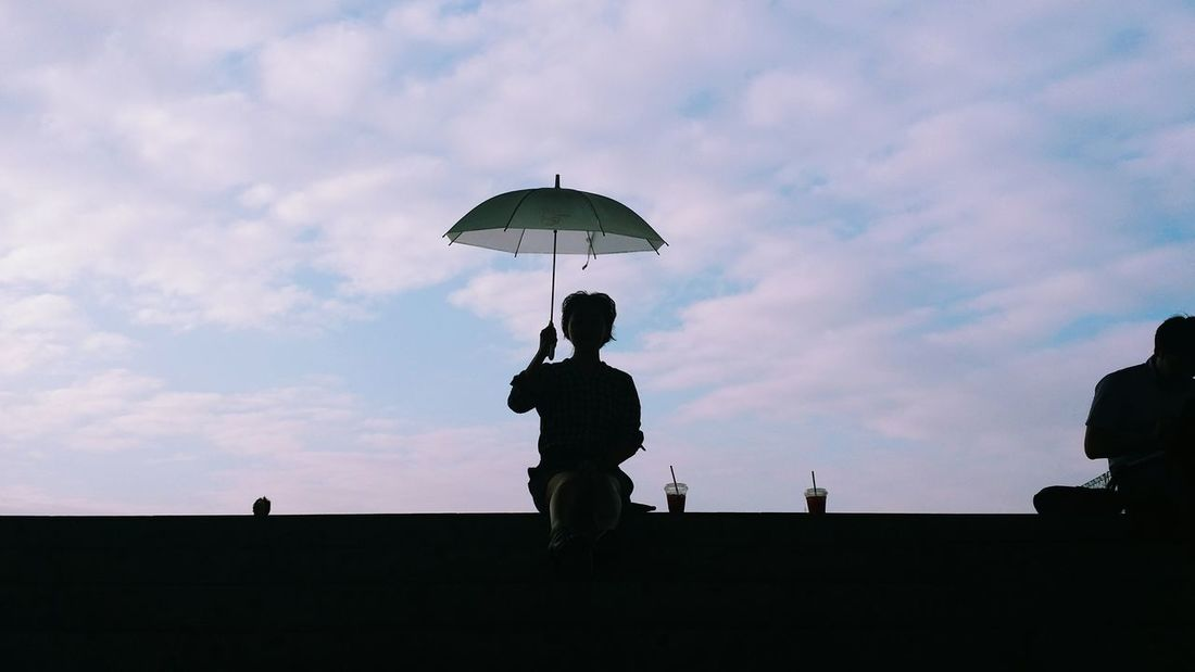 holding an Umbrella and blue sky