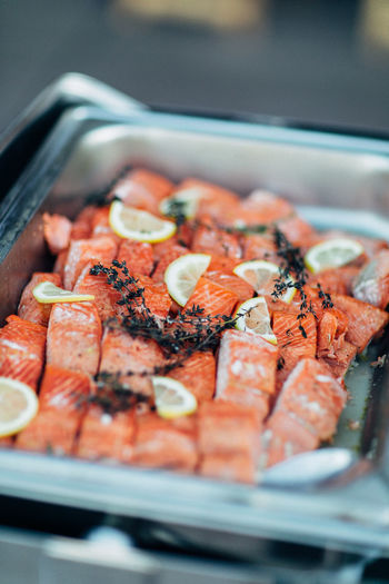 High angle view of fish with lemon slices in tray