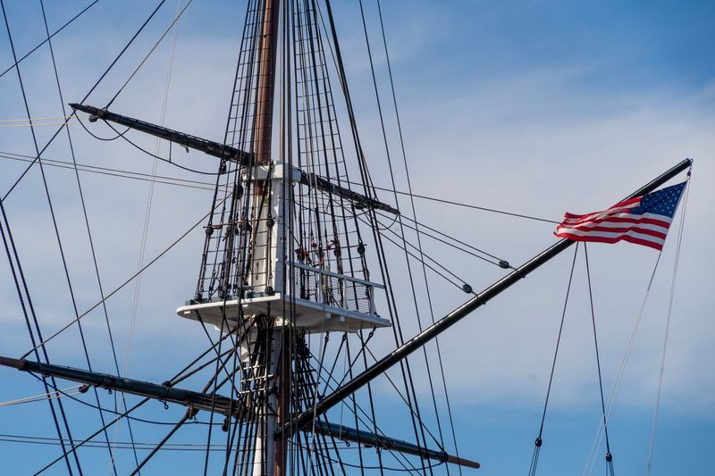 Ship Mast USS Constitution Boston, Massachusetts Boston United States Flag  USA Flag Sky Patriotism Low Angle View Blue Nature No People Pole Connection Architecture Built Structure Cable Outdoors Day Clear Sky Pride Star Shape Sailboat National Icon Complexity