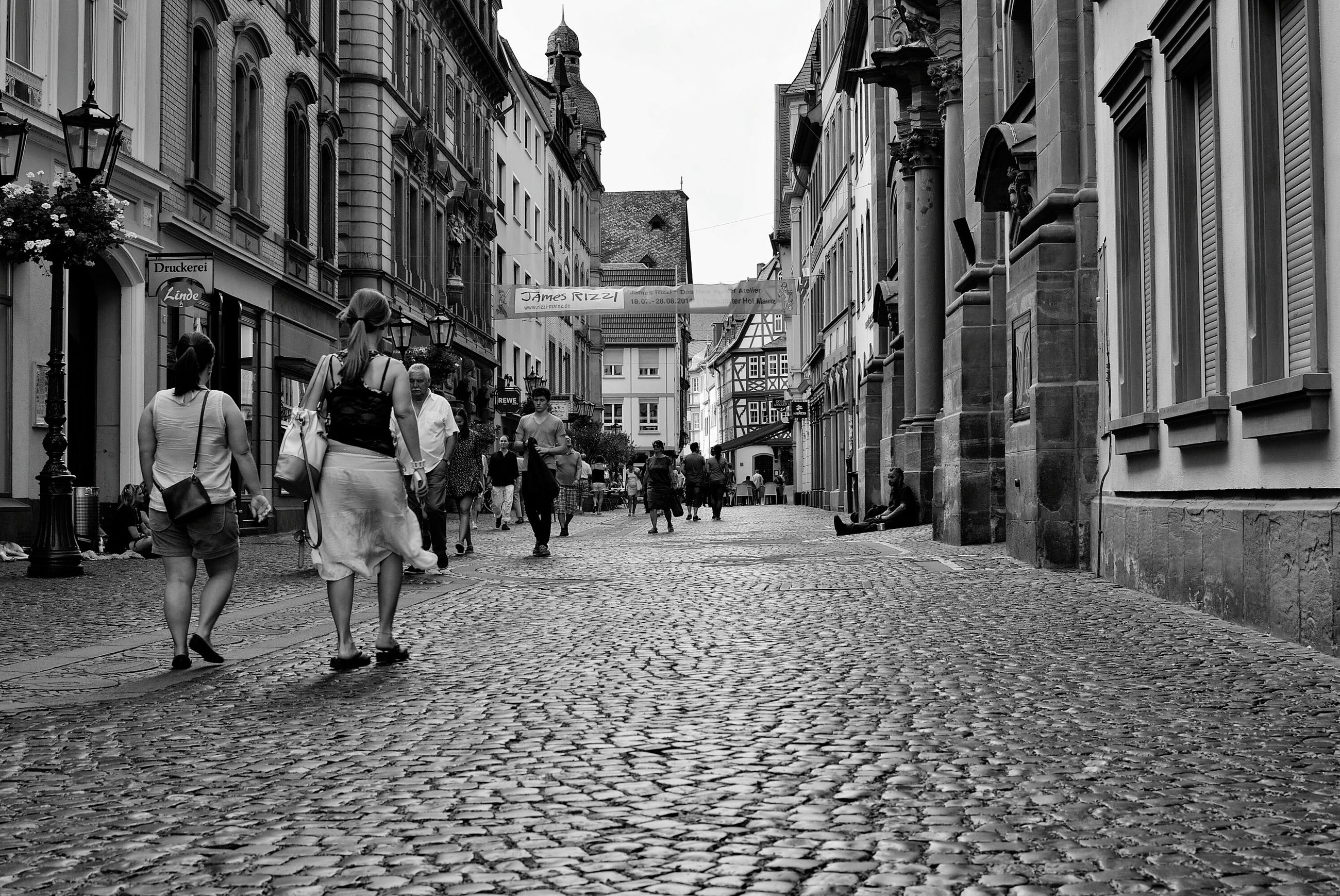 building exterior, architecture, built structure, the way forward, street, walking, city, men, cobblestone, person, diminishing perspective, building, city life, lifestyles, residential building, vanishing point, residential structure, alley, incidental people