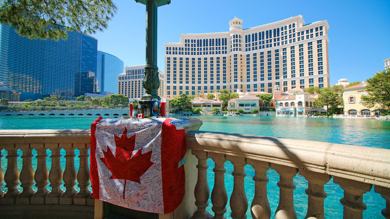 LAS VEGAS - OCT 10 ,2017 : Canadian flag with messages of the Las Vegas Shooting victims front of the Bellagio. 43 Golden Moments Bellagio Fountains Canadian EyeEm Gallery EyeEmNewHere Getty Getty+EyeEm Collection Second Acts Travel Vegas Strong After Shooting America Architecture Bellagio Building Exterior Built Structure Flag Gun Control International Landmark News Shooting Stockphoto Stockphotography Travel Destinations Water