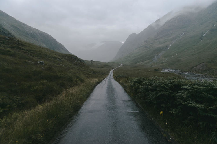 Scenic view of scottish highlands against cloudy sky