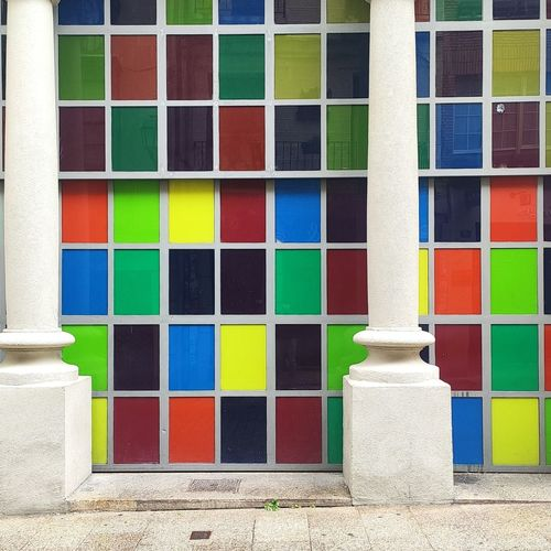 Multi colored windows on wall of building