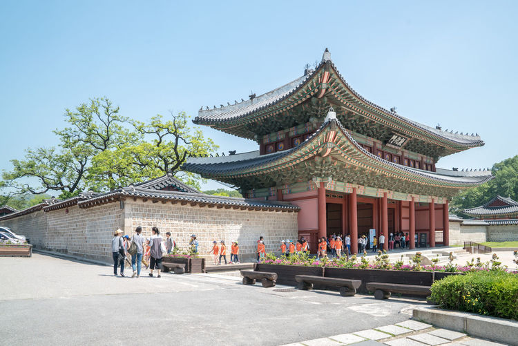 Tourists at pagoda during sunny day