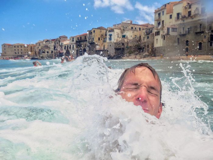 Italy, Sicily Water One Person Motion Leisure Activity Nature Lifestyles Summer Exploratorium Swimming Outdoors Portrait Sea Architecture Building Exterior