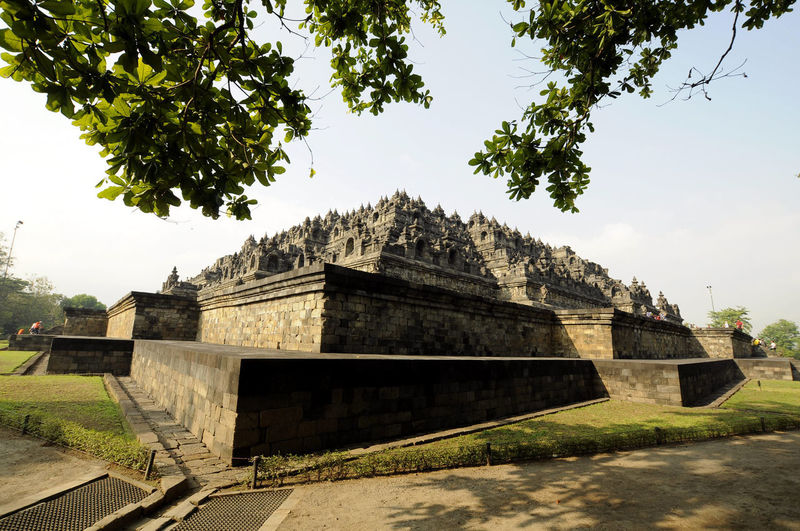 Borobudur Temple On Different Angle INDONESIA Ancient Ancient Civilization Architecture Belief Borobudur Building Exterior Built Structure Central Java Clear Sky Day History Nature Outdoors Place Of Worship Plant Religion Sky Spirituality Temple The Past Tourism Travel Destinations Tree