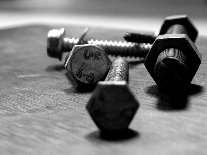 Close-up of screws and bolts on table
