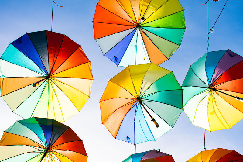 Low angle view of multi colored umbrella against sky