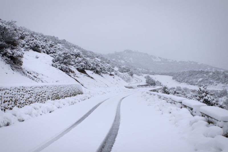 Snow Covered Road Along Landscape
