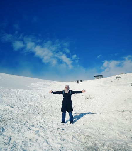 Full length of man standing on snow covered land