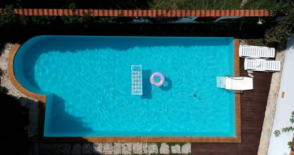 High angle view of blue floating on swimming pool