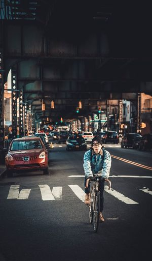 Transportation Mode Of Transport Land Vehicle Real People Street Built Structure Bicycle City Architecture Building Exterior Car Lifestyles Road Full Length Men City Life One Person Women Outdoors Night New York City New Broklyn Bridge Broklyn